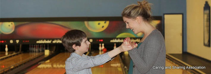 CASA child member and Volunteer at bowling
